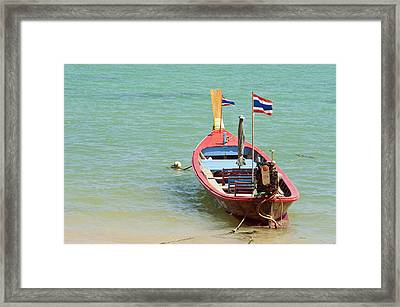 Longtail Boat At Sea Framed Print by Bill Brennan