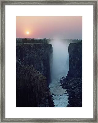 Looking Along Victoria Falls At Dusk Framed Print by Axiom Photographic