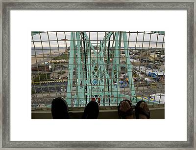 Looking Down At Two Peoples Feet Framed Print by Todd Gipstein