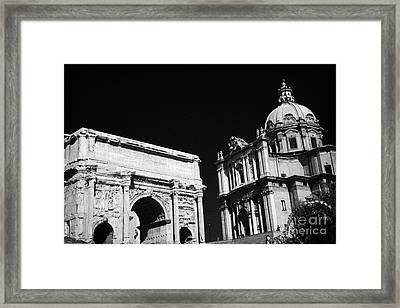 Looking Up From The Imperial Roman Forum Towards Campidoglio Showing Arch Of Septimius Severus Framed Print