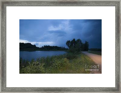 Looming Alberta Storm Framed Print by Darcy Michaelchuk
