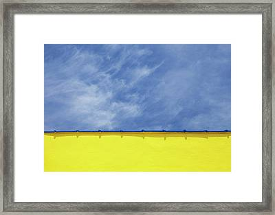 Low Angle Close Up View Of A Wall And Sky Framed Print by Sean Russell