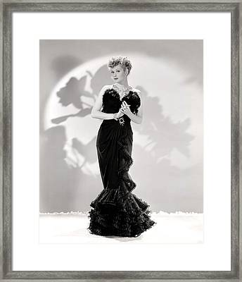 Lucille Ball Models A Lovely Black Framed Print by Everett