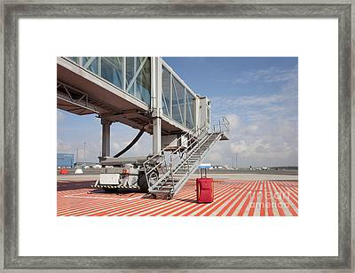 Luggage At A Gate Bridge Framed Print