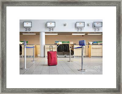 Luggage At An Airline Check-in Counter Framed Print