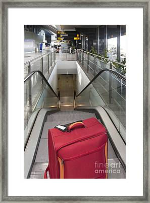 Luggage At The Top Of An Escalator Framed Print
