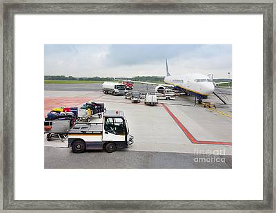 Luggage Transported To An Airprot Framed Print by Jaak Nilson