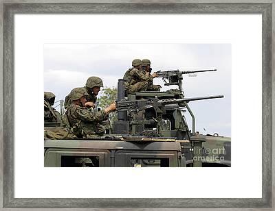 Machine Gunners Fire Machine Guns Framed Print by Stocktrek Images