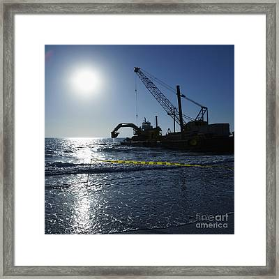 Machinery Cleaning Up A Pier Framed Print by Skip Nall
