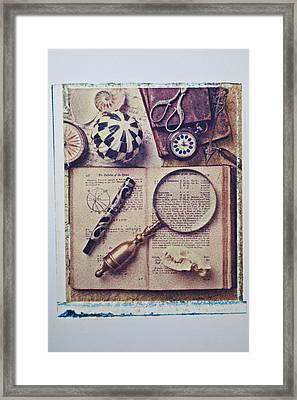 Magnifying Glass On Old Book Framed Print by Garry Gay