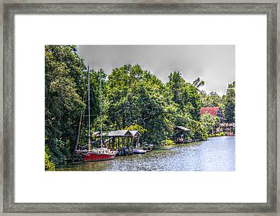 Magnolia River With A Red Sailboat Framed Print