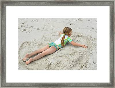 Framed Print featuring the photograph Making A Sand Angel by Maureen E Ritter