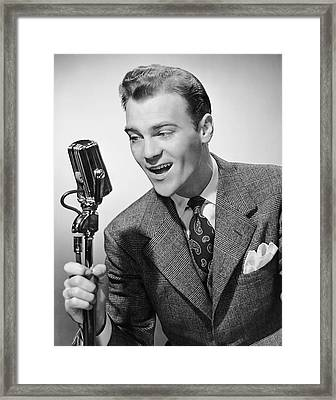 Male Singer Holding Microphone Framed Print by George Marks