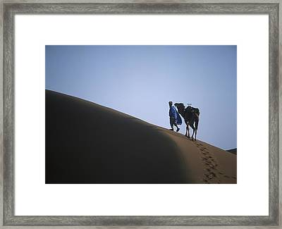 Man And Camel On Sand Dune Framed Print by Axiom Photographic