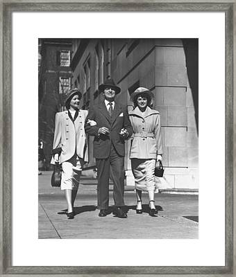 Man And Two Women Walking On Sidewalk, (b&w) Framed Print by George Marks