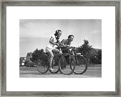 Man And Woman Riding Bicycles, (b&w), Framed Print by George Marks