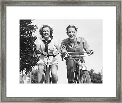 Man And Woman Riding Bikes, (b&w), Low Angle View Framed Print