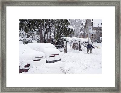 Man Clearing Snow, Braemar, Scotland Framed Print by Duncan Shaw