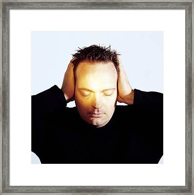 Man Covering His Ears Framed Print by Cristina Pedrazzini