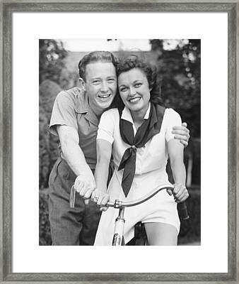 Man Embracing Woman Sitting On Bike, (b&w), Portrait Framed Print