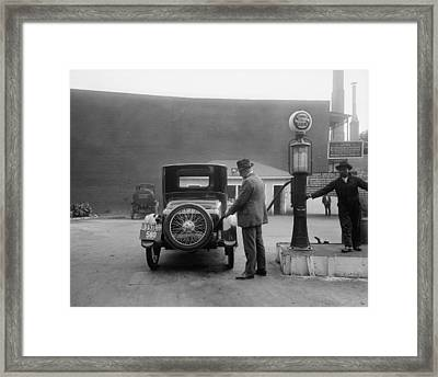 Man Fueling His Car At A Self-service Framed Print by Everett