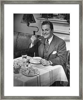 Man Having Dinner Framed Print by George Marks