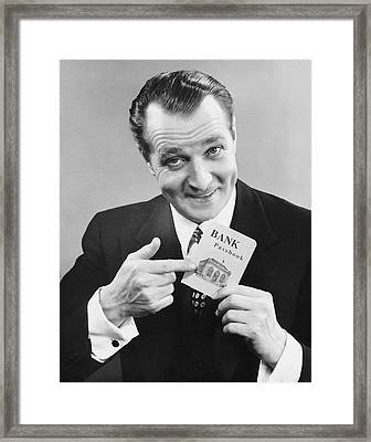 Man Holding Bank Book Framed Print by George Marks