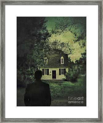 Man In Front Of Cottage Framed Print by Jill Battaglia