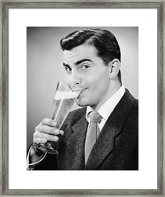 Man In Suit Drinking Tall Glass Of Beer Framed Print by George Marks