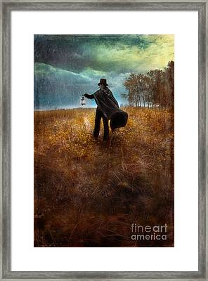 Man In Top Hat And Cape Walking In Rain Framed Print by Jill Battaglia