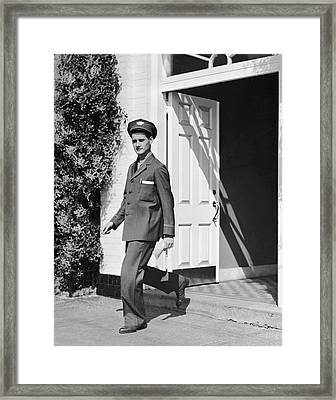 Man In Uniform Walking Out Door Framed Print by George Marks