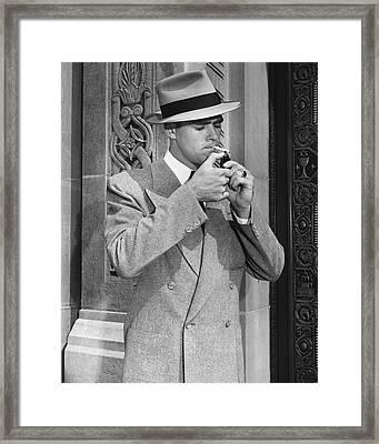 Man Lighting Cigarette Framed Print by George Marks