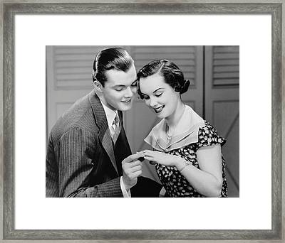 Man Looking At Woman's Ring Framed Print by George Marks