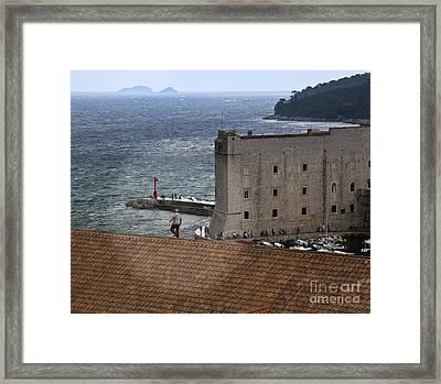 Man On The Roof In Dubrovnik Framed Print by Madeline Ellis
