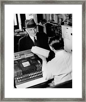 Man Picking Up Prescription In Pharmacy Framed Print by George Marks