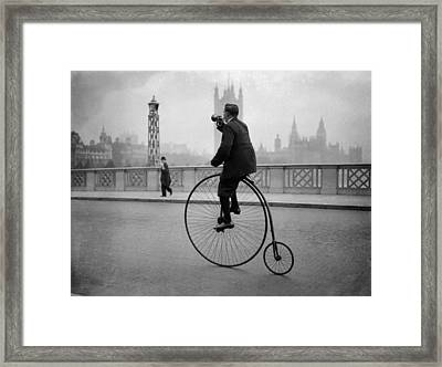 Man Rides A Penny Farthing Bicycle Over Lambeth Bridge, London Framed Print by Fox Photos