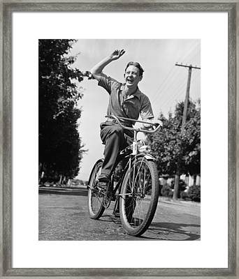 Man Riding Bicycle, Waving, (b&w) Framed Print by George Marks