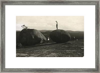 Man Stands Atop A Huge Boulder On Bald Framed Print by Herbert E. Gregory