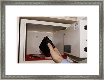 Man Taking Wallet From Hotel In-room Safe Framed Print by Mark Williamson
