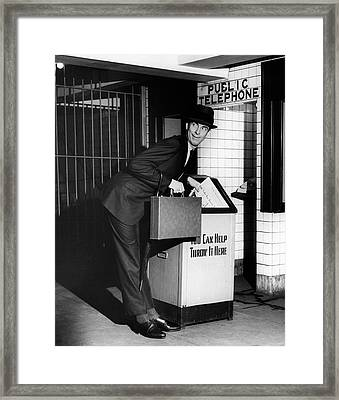 Man Throwing Away Newspaper Framed Print by George Marks