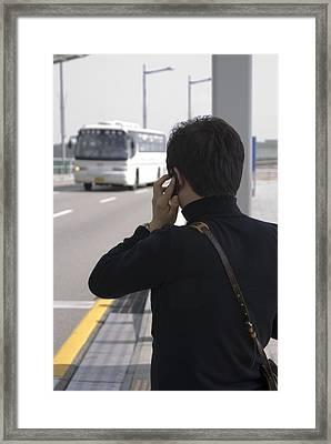Man Using Mobile Phone Framed Print