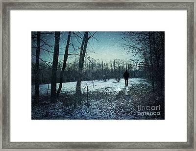 Man Walking In Snow At Winter Twilight Framed Print