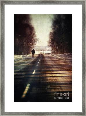 Man Walking On A Rural Winter Road Framed Print