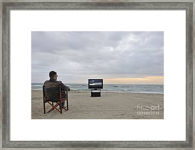 Man Watching Tv On Beach At Sunset Framed Print by Sami Sarkis