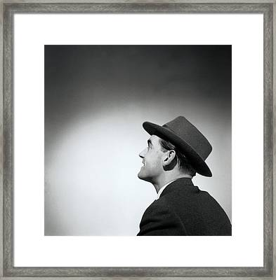 Man Wearing Hat Looking In Distance (b&w) Framed Print by Hulton Archive