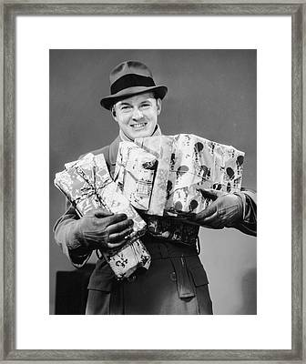 Man With Coat, Gloves And Hat Carrying Christmas Gifts Framed Print by George Marks