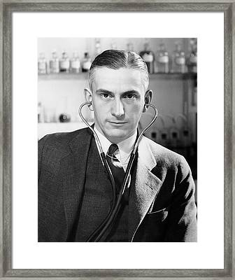 Man With Stethoscope On His Head Framed Print by George Marks
