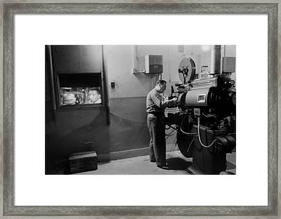 Man Working A Projector In A Movie Framed Print by Everett