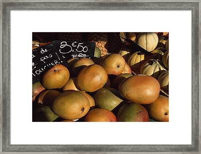 Mangoes And Melons Priced In Euros Framed Print by David Evans
