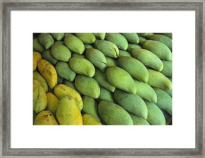 Mangoes Sold At A Market Framed Print by Todd Gipstein